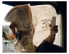 Larry Sultan - Capturing a daily occurrence in a really interesting way. The light streaming through the paper from behind the window illuminates the text and image in the paper. Revealing little about the person in the image apart from perhaps he is a business man.