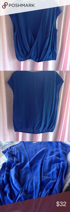 Halogen Marine Blue Sleeveless Top 2 available🌺🌺Luxurious marine blue faux wrap top by Halogen. Hidden elastic at hem. Material is silk and viscose. Tag reads dry clean, delicate wash is fine.  Never worn. Excellent condition. Sz S and Sz M Halogen Tops Blouses