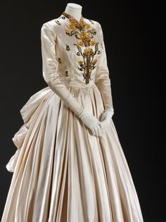 Evening dress Jacques Fath Spring/Summer 1948 Lady Alexandra Howard-Johnston was the wife of the Naval Attachéto Paris, 1948-50. She required an extensive wardrobe for the many formal dinners and state functions that she had to attend.  Lady Alexandra wore this dress at the official visit of Princess Elizabeth and Prince Philip to Paris in May 1948. She recalled that when she arrived at the Theatre de L'Opéra with her husband, the Garde Nationale suddenly sprang to attention. 'I real...