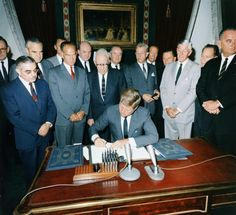 Kennedy signs the Nuclear Test Ban Treaty in the White House Treaty Room on Oct. 7, 1963.