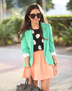 mint blazer, polka dot blouse, peach skirt.
