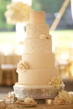 A tall elegant wedding cake featured beautiful beaded details, ivory rose clusters, and a lace pattern resembling the bride's wedding dress. #WhiteWeddingCake Photography by: Amanda Sudimack for Artisan Events. Read More: http://www.insideweddings.com/weddings/a-fairy-tale-wedding-fit-for-former-miss-illinois/569/#.VXCKyjswUsM.gmail