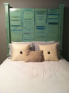 4 antique shutters, two 4x4's, and some wooden fence toppers. Screw that all together and you have a perfectly queen-sized headboard! Made by and courtesy of mrsemilynorthington