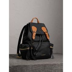 Inspired by military archive bags, our timeless backpack in showerproof nylon and finished with topstitched leather trims.