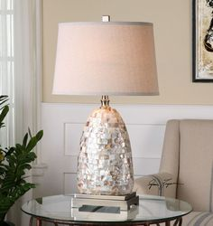 A hint of glamour! Layers of mosaic creamy iridescent Capiz Shell tiles make up with tall table lamp, accented with stylish plated brushed nickel metal details.  Luxury and elegance!