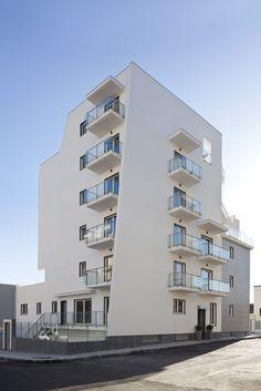 white architecture, catania bulding, la vela