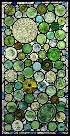 """A """"stained glass"""" window made of bottle bottoms, serving plates, jar lids, ect."""