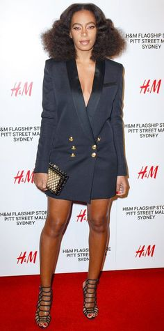 Solange Knowles hit the H&M Sydney flagship store party in a sleek oversize double-breasted tuxedo blazer that served as her dress. She accessorized with a netted clutch and black Schutz cage sandals.