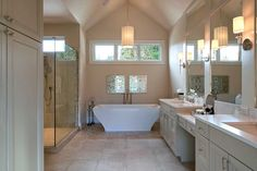 bathroom with wall sconces and pendant lighting