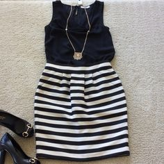"""Banana Republic striped knit tulip skirt Super cute Banana Republic stripes knit tulip skirt. Black and ivory stripe. Pleated in the front. Side pockets. Back zip and hook closure. Lined. Laying flat approx 21"""" long, waist approx 14.5"""" across. 60 rayon 27 polyester 13 nylon. Size 2. NWT, never worn.  #238 Banana Republic Skirts Mini"""