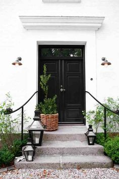 home exteriors - black double doors, black front doors, iron railing, Birgitta Wolfgang Gorgeous home exterior with glossy black doors and Exterior Design, Cottage House Exterior, Entrance, Doors, House Exterior, Interior And Exterior, Front Entrances, Black Front Doors, Black Doors