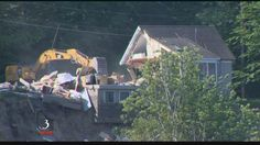 A house hanging on the edge of the Winooski River in Burlington was torn down Monday morning.