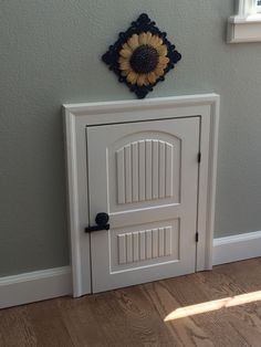 Doggy door my husband made. When it's open the normal flap is there to go outside. We leave the door open during the day and close it at night.