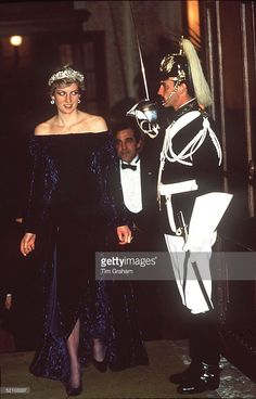 Princess Diana Arriving For A Dinner Hosted By The Presidentat The Ajuda Palace In Lisbon,portugal. Wearing A Crushed Velvet Purple Evening Dress Designed By Fashion Designer Bruce Oldfield And Wearing The Spencer Tiara