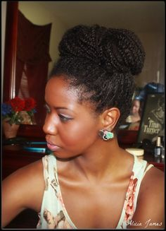 Alicia James styled her loose twists into a high bun.