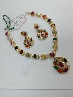 Give a new flavour to your bridal jewellery with these Navaratan necklace embedded with precious gemstones. Emerald Jewelry, Gold Jewelry, Beaded Jewelry, Jewelery, Gold Pendent, India Jewelry, Gold Jewellery Design, Necklace Designs, Pendant Jewelry