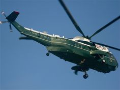 Marine One flies in a formation with a chase bird following.