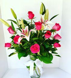 Pink roses and pink stargazer lilies. Flower arrangement. One dozen roses.!