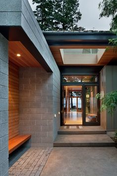 Modern Exterior of Home with Concrete walkway, Built-in bench seating, Shag Mixed Stripe, French doors, Transom window, Entry