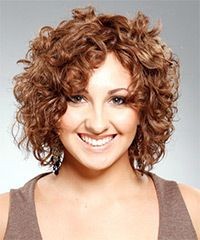 Salon Hairstyle: Casual Medium Curly Hairstyle - Short to long layers cut all over this hairstyle gives it plenty of body and bounce. Its great for those with naturally curly hair who want to let their curls go wild.