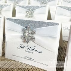 """The Elsa Collection - Luxury Place Card   Featuring white velvet ribbon, silver glitter paper and """"Diamante Snow"""" snowflake crystal embellishment   Luxury handmade wedding invitations and stationery #byenchanting"""