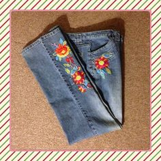 "Stretchy Jeans with Flower Power! Price drop Boot cut Jeans Flower Accents on the Left leg and right pocket. 55% Rayon 25% Cotton 2% Spandex. 30"" inseam METROSTYLE Pants"