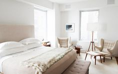 The Best It-Girl Bedrooms// all-white bedroom, fur blanket, Danish lounge chairs