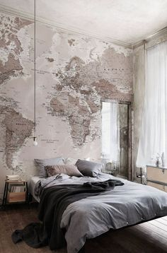 Soft neutrals work a dream in this bedroom. This world map wallpaper adds a nice decorative touch to the room!