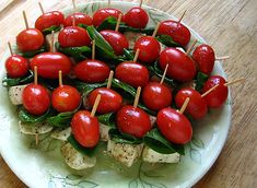 Sweet basil and fresh mozzarella, all drizzled with balsamic vinaigrette.    Perfect for a summer event!