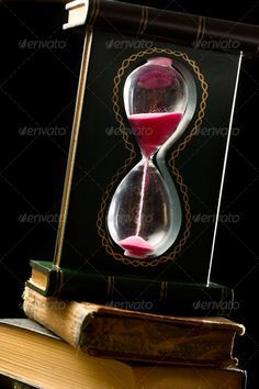 A pile of old books and sand glass on black ...  antique, black, book, bulb, clock, countdown, cover, cylinder, deadline, education, equipment, fall, flow, glass, hourglass, hurry, instrument, library, measurement, minute, object, opportunity, paper, passing, past, process, pyramid, red, reflection, running, sand, second, sign, time, timer, tool, transparent, vertical, vessel, vintage, waiting, waste, watch, wooden, yellow