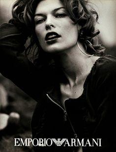 Campaign: Emporio Armani  Season: 2003 Models: Bruno Santos,  Milla Jovovich  Photographer: Peter Lindbergh