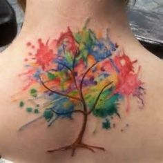 Tree watercolor tattoo! I really like the minimal branches with the explosion of color tattoo inspiration