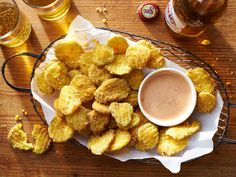 Fried Pickle Chips Recipe | There's only thing better than fried pickles and that's fried pickles dipped in our Roundhouse-Kick Sauce. So, you thought ranch dressing was the end-all when it came to dippable condiments? Prepare to be amazed at this zesty little number. It calls for mayonnaise, chili sauce, ketchup, vinegar, Sriracha and Worcestershire. Add a dash of smoked paprika, a pinch of salt and dried mustard, and a sprinkling of pepper and you have one tasty sauce perfect for our Fried