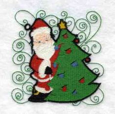This free embroidery design is a Santa and Christmas Tree.