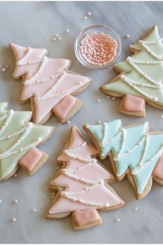 Fill in these chic christmas cookies with pink, blue, or green royal icing. Sprinkle sanding sugar on top and lay pink pearl nonpareils for decor. Get the recipe at Bake at cookies Easy Christmas Treats That'll Make Holiday Baking Even More Joyful Easy Christmas Treats, Christmas Sugar Cookies, Christmas Sweets, Christmas Cooking, Noel Christmas, Christmas Goodies, Holiday Cookies, Holiday Treats, Simple Christmas