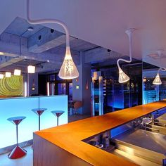 Syn Bar in Japan with Pipe suspension by Herzog & De Meuron and Logico suspension by Gerhard Reichert and Michele De Lucchi. Project by Shinji Yoritani Photo by Sergio Pirrone #artemide_lighting #artemide #lightdesign #design #madeinitaly #quality #interior #interior_design #architecture #light #reasturant #hospitality #suspension #pipe #logico @micheledelucchiinstagram