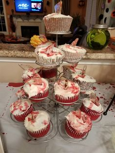 Red velvet cupcakes, cream cheese frosting, edible blood drippings and sugar shards.