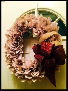Wreath of Book Pages - Beautiful & Unique! by FriendshipRingWreath on Etsy https://www.etsy.com/listing/218602270/wreath-of-book-pages-beautiful-unique