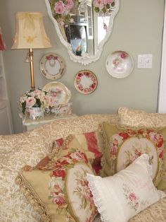 Love the pillows ~ and the plates on the wall, my favorite look