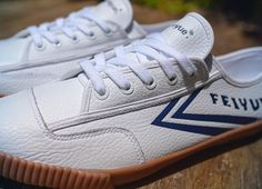 74e90f77a6 The men s Fe Lo Plain White blends  classic design with luxe leather  details  Feiyue