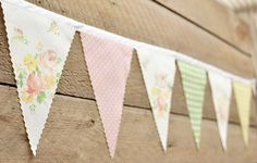 Getting married? Having a party? Decorating a room? A cafe? Add some whimsy with a vintage bunting!    Bunting Barb, aka my mother-in-law, has been sewing for 50 + years. She has lovingly created this handmade vintage bunting. (In fact, she makes ALL of our buntings!)    This bunting is 9 2 from end to end, with 12 flags sewn in. Two feet of bias tape is at each end of this bunting for easy tying. Each flag measures 5 x 7.    Most of our buntings are made with vintage fabrics, with the odd…