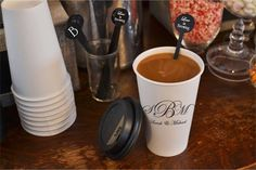 Personalized cups and swizzle sticks add a little extra flair to your coffee and hot cocoa bar and turn your guests' fun drink creations into take-home favors. Order personalized wedding coffee cups here: