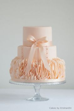 ruffles with a peach colored wedding cake.  Vertical ruffles