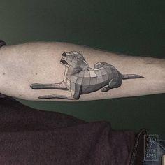 Polygonal dog tattoo on the left inner forearm.
