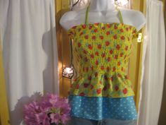 Child size large 26 to 33 inch chest yellow blue Polka Dot Flower stretch top. $25.00, via Etsy.