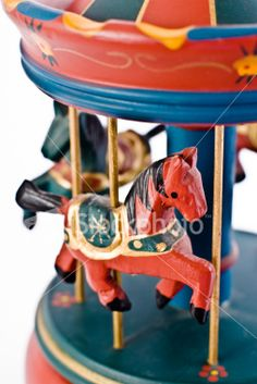 Small Colored Carillon with Horse on a White Background Royalty Free Stock Photo $2