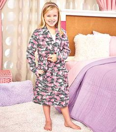 The Kids' Fleece Camo Robe is ideal for a lazy day. This long-sleeved, cozy robe has a loose, comfortable fit. The belt is attached to the back to prevent it from getting lost. Two front patch pockets are ideal for holding toys or snacks. Polyester. Mach