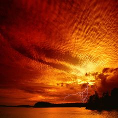 amazing that both the sunset and the lightning are captured