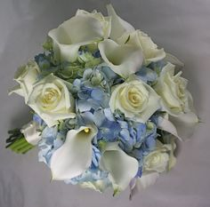 Light blue hydrangeas with white roses and white calla lilies wedding bouquet.