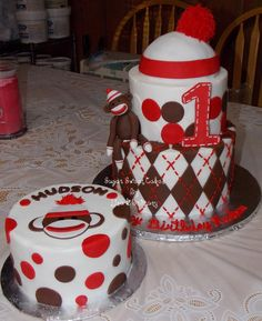 """Sock Monkey - 6"""" & 8"""" cakes iced in buttercream. The hat is styrofoam covered in fondant. All decorations are fondant. This cake also came with a matching smash cake. TFL!"""
